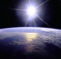 Full sunburst over Earth (NASA)